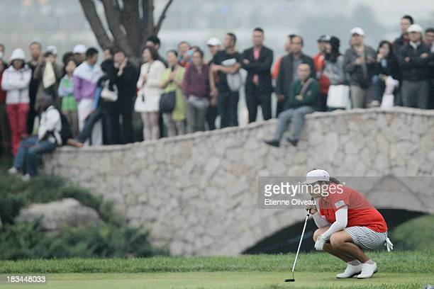Shanshan Feng of China lines up her putt on the 17th tee during the final round of the Reignwood LPGA Classic at Pine Valley Golf Club on October 6...