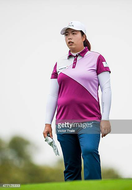 Shanshan Feng of China looks on the 4th hole during round one of the World Ladies Championship at Mission Hills' Blackstone Course on March 7 2014 in...