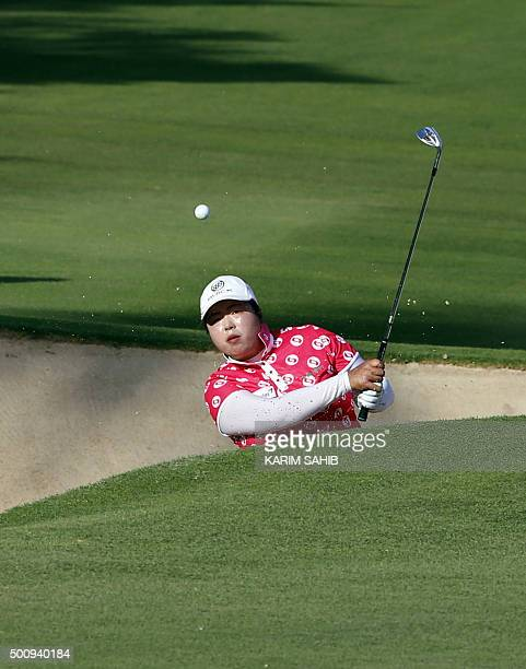 Shanshan Feng of China plays a shot during the third round of the Dubai Ladies Masters in Dubai on December 11 2015 AFP PHOTO / KARIM SAHIB / AFP /...