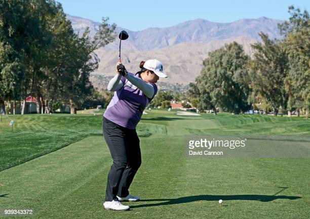 Shanshan Feng of China plays a shot from the third tee during the proam as a preview for the 2018 ANA Inspiration on the Dinah Shore Tournament...