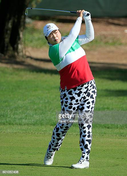 Shanshan Feng of China plays her second shot on the par 4 ninth hole during the final round of the 2015 Omega Dubai Ladies Masters on the Majlis...