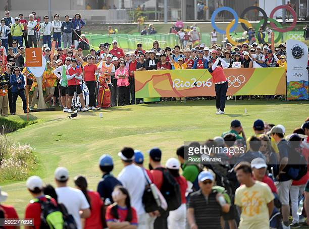 Shanshan Feng of China plays her shot from the first tee during the Women's Golf Final on Day 15 of the Rio 2016 Olympic Games at the Olympic Golf...