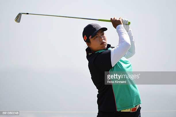 Shanshan Feng of China plays her shot from the fourth tee during the First Round of Women's Golf at Olympic Golf Course on Day 12 of the Rio 2016...