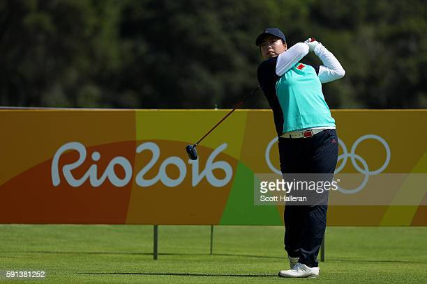 Shanshan Feng of China plays her shot from the third tee during the First Round of Women's Golf on Day 12 of the Rio 2016 Olympic Games at Olympic...