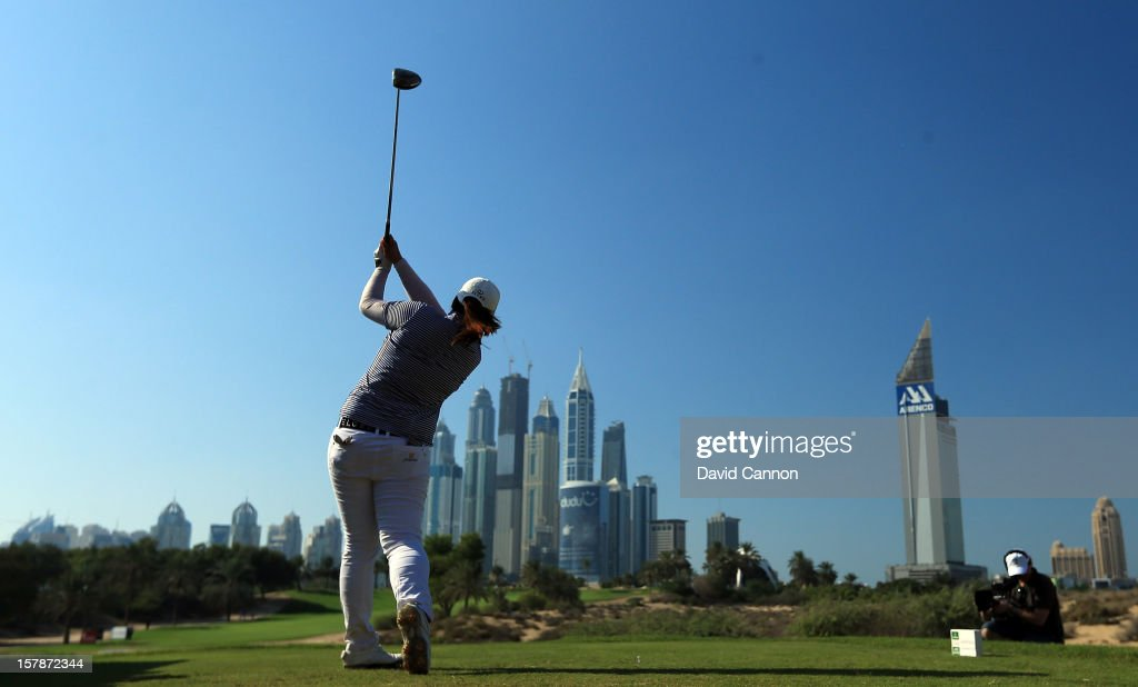 Shanshan Feng of China plays her tee shot at the par 4, 8th hole during the third round of the 2012 Omega Dubai Ladies Masters on the Majilis Course at the Emirates Golf Club on December 7, 2012 in Dubai, United Arab Emirates.