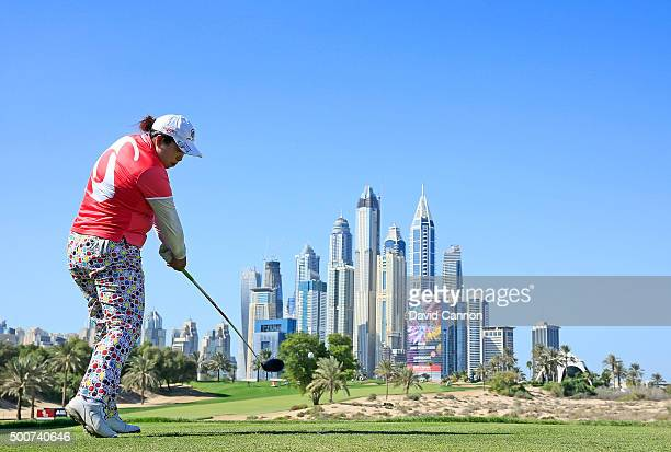 Shanshan Feng of China plays her tee shot on the par 4 eighth hole during the second round of the 2015 Omega Dubai Ladies Masters on the Majlis...