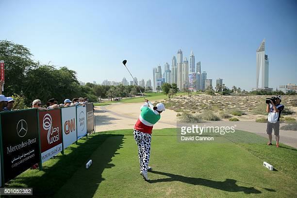 Shanshan Feng of China plays her tee shot on the par 4 eighth hole during the final round of the 2015 Omega Dubai Ladies Masters on the Majlis Course...
