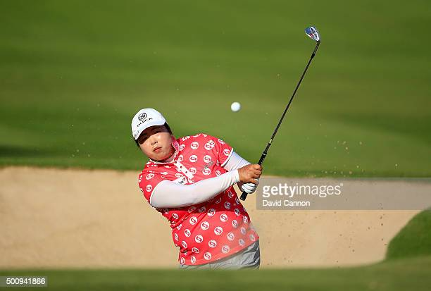 Shanshan Feng of China plays her third shot on the par 4 14th hole during the third round of the 2015 Omega Dubai Ladies Masters on the Majlis Course...