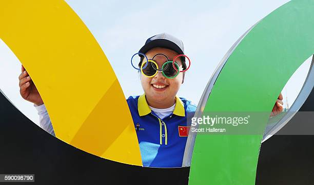 Shanshan Feng of China poses during a practice round prior to the start of the women's golf during Day 11 of the Rio 2016 Olympic Games at Olympic...