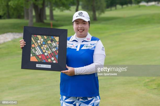Shanshan Feng of China poses for photographs with the winner's trophy during the awards ceremony at the conclusion of the final round of the LPGA...