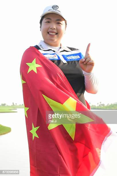 Shanshan Feng of China poses with the Chinese flag during a photo shoot after winning The Blue Bay LPGA on November 13 2017 in Hainan Island China...