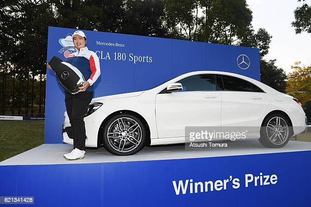 Shanshan Feng of China poses with the prize car after winning the TOTO Japan Classics 2016 at the Taiheiyo Club Minori Course on November 6 2016 in...