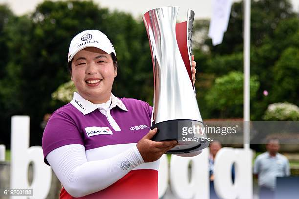 Shanshan Feng of China poses with the Sime Darby LPGA trophy after she won it 17 under par 267 during day four of the Sime Darby LPGA at TPC Kuala...