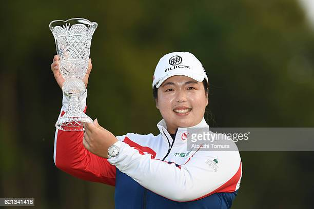 Shanshan Feng of China poses with the trophy after winning the TOTO Japan Classics 2016 at the Taiheiyo Club Minori Course on November 6 2016 in...