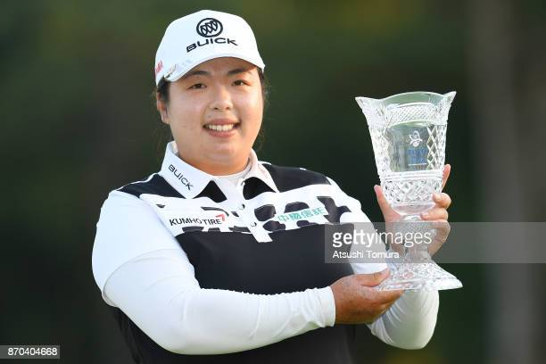 Shanshan Feng of China poses with the trophy after winning the TOTO Japan Classics 2017 at the Taiheiyo Club Minori Course on November 5 2017 in...