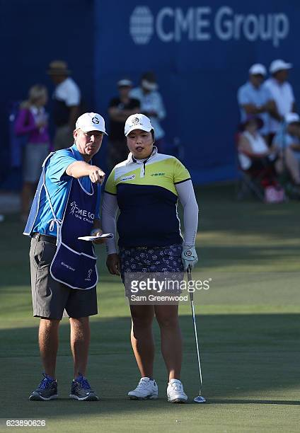 Shanshan Feng of China prepares to putt on the 18th hole during the first round of the CME Group Tour Championship at Tiburon Golf Club on November...