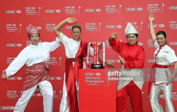 Shanshan Feng of China Suzann Pettersen of Norway Inbee Park of South Korea and Paula Creamer of the USA strike a pose next to the trophy during a...