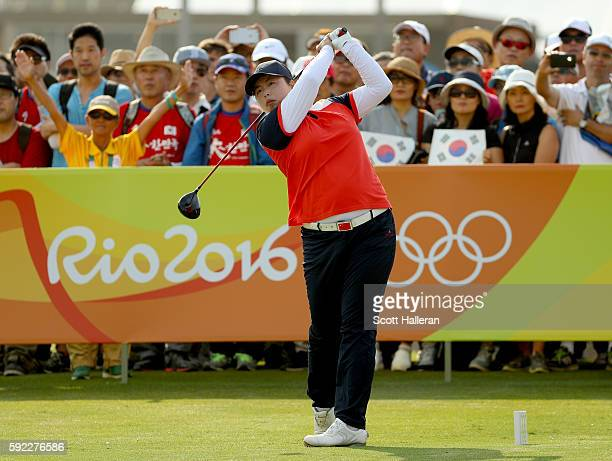 Shanshan Feng of China tees off on the first hole at the Women's Golf Final on Day 15 of the Rio 2016 Olympic Games at the Olympic Golf Course on...