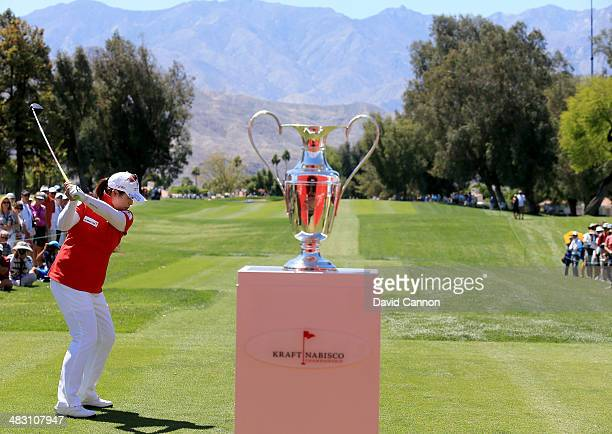Shanshan feng of China tees off on the first hole during the final round of the 2014 Kraft Nabisco Championship on the Dinah Shore Tournament Course...