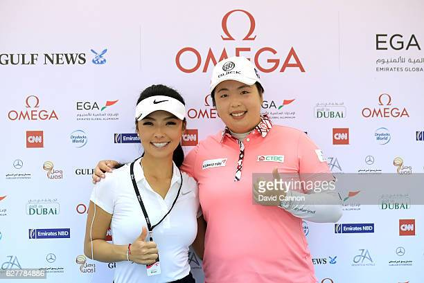 Shanshan Feng of China the defending champion poses with Muni He of China the young amateur prodigy as a preview for the 2016 Omega Dubai Ladies...