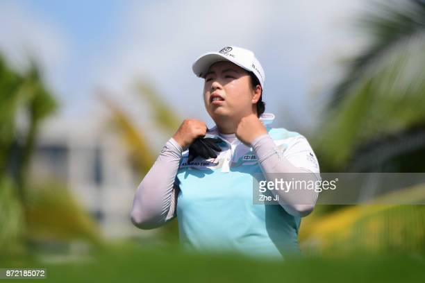 Shanshan Feng of China waits to play a shot on the 12th hole during the second round of the Blue Bay LPGA at Jian Lake Blue Bay golf course on...