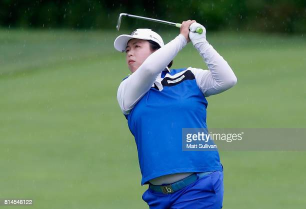 Shanshan Feng of China watches her second shot on the second hole during the second round of the US Women's Open Championship at Trump National Golf...