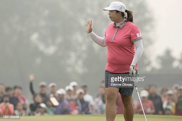 Shanshan Feng of China waves to spectators during the third round of the Reignwood LPGA Classic at Pine Valley Golf Club on October 5 2013 in Beijing...