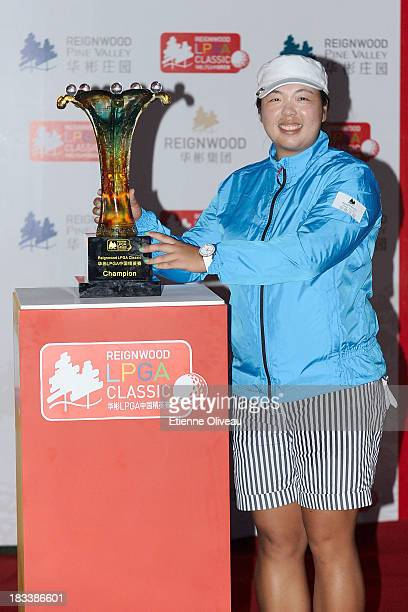 Shanshan Feng poses next to her trophy during the closing ceremony of the Reignwood LPGA Classic at Pine Valley Golf Club on October 6 2013 in...