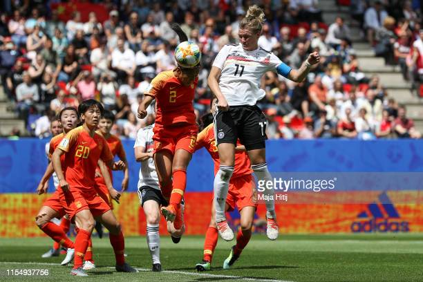 Shanshan Liu of China jumps for the ball with Alexandra Popp of Germany during the 2019 FIFA Women's World Cup France group B match between Germany...