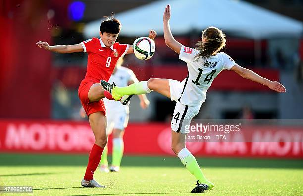 Shanshan Wang of China is challenged by Morgan Brian of USA during the FIFA Women's World Cup 2015 Quarter Final match between China and United...