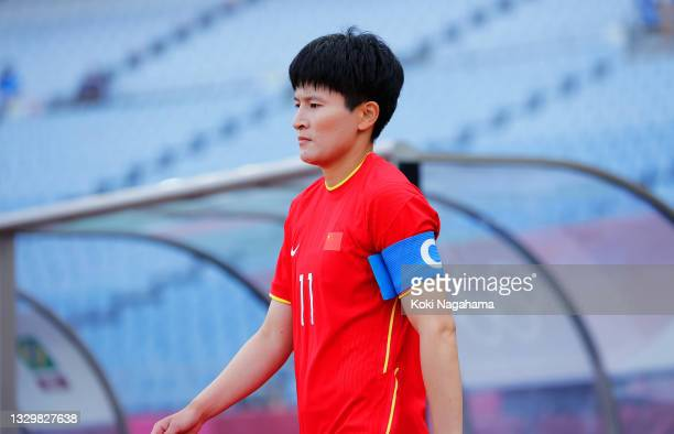 Shanshan Wang of Team China leads the team on to the pitch prior to the Women's First Round Group F match between China and Brazil during the Tokyo...