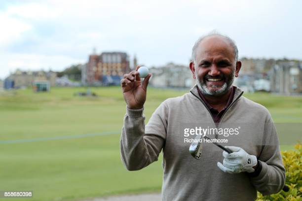 Shantanu Narayen CEO of Adobe Systems poses with his golf ball after his round Shantanu Narayen scored a holeinone on the 11th hole during day three...