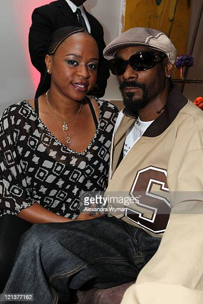 Shante Broadus and Snoop Dogg at La La's Full Court Life Premiere Party held at The Mark on August 18 2011 in Los Angeles California