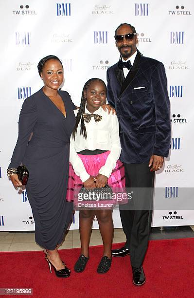 Shante Broadus Cori Broadus and rapper Snoop Dogg arrive at the 11th Annual BMI Urban Awards held at the Pantages Theatre on August 26 2011 in...