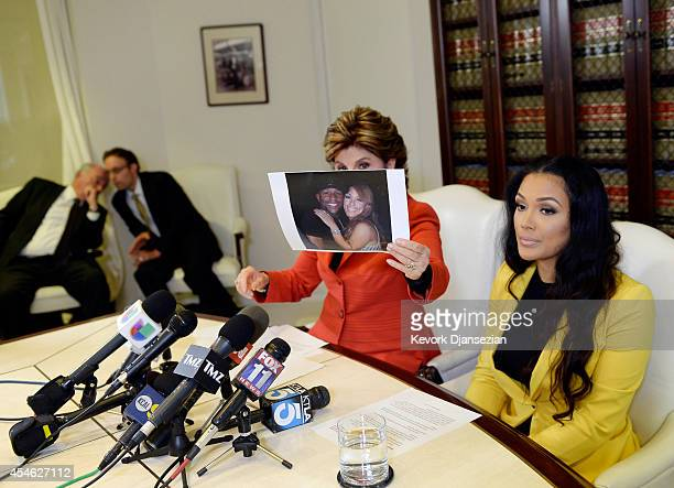 Shantel Jackson exfiancee of boxer Floyd Mayweather Jr looks on as her attorney Gloria Allred holds up a photograph after announcing a lawsuit...