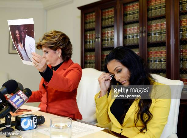 Shantel Jackson exfiancee of boxer Floyd Mayweather Jr looks on as her attorney Gloria Allred holds up a photograph of the couple after announcing a...
