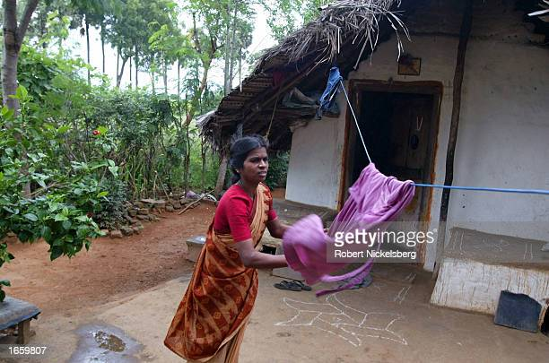 Shanti 35yearsold hangs laundry November 8 2002 in Alwarthangal a village of 300 families in the Indian state of Tamil Nadu Shanti tested positive...