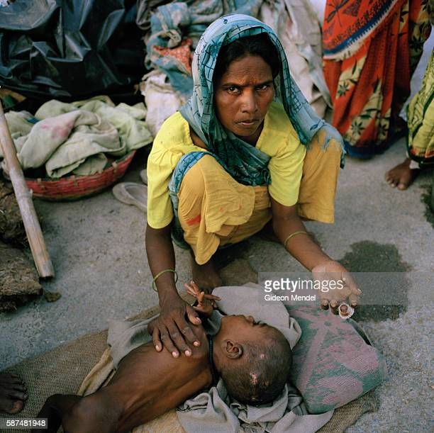 Shanti Devi with her malnourished son on the roadside near Sirohinagar village. They had to flee floodwaters, which destroyed their home to seek...