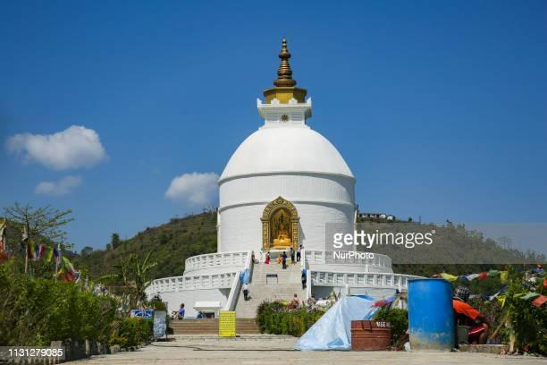 Shanti Stupa, a Buddhist pagoda on Anadu Hill over Phewa / Fewa lake in Pokhara, Nepal. The stupa is a shrine - symbol of peace, known as World Peace...