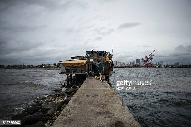 Shanties at the breakwater of Baseco Tondo Manila are seen on October 20 2016 One of the most powerful typhoons to ever hit the Philippines destroyed...