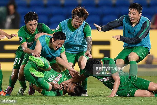 Shao Jiayi of Beijing Guoan celebrates with team mates during the AFC Asian Champions League match between Brisbane Roar and Beijing Guoan at Cbus...