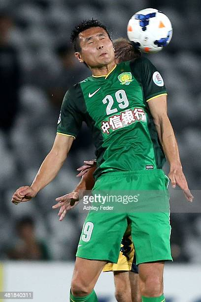 Shao Jiayi of Beijing Guoan heads the ball during the Asian Champions League match between the Central Coast Mariners and Beijing Guoan at Bluetongue...