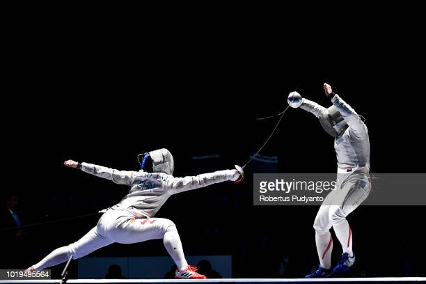 Shao Yaqi of China competes against Tamura Norika of Japan during Women's Sabre Individual Semifinal match on day one of the Asian Games on August...