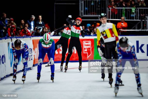 Shaoang Liu and Shaolin Sandor Liu of Hungary celebrate finishing first and second in the overall classification after the Men's 3000m super final...