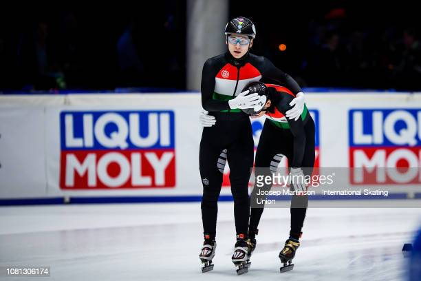 Shaoang Liu of Hungary and Shaolin Sandor Liu of Hungary react after finishing first and second in the Men's 1500m final during the ISU European...