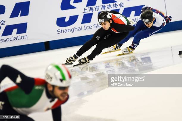 Shaoang Liu of Hungary and Victor An of Russia compete during the men's 5000m relay final B event at the ISU World Cup Short Track in Shanghai on...