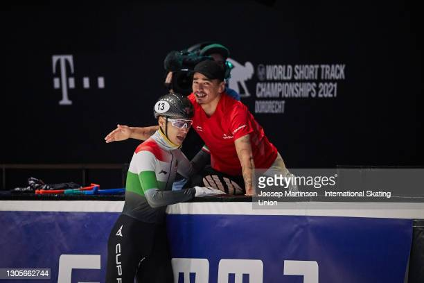 Shaoang Liu of Hungary celebrates with his brother Shaolin Sandor Liu after crossing the finish line first in the Men's 500m final during day 2 of...