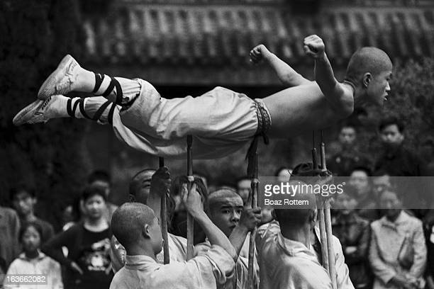 Shaolin Buddhist monks performing in acrobatic skills.