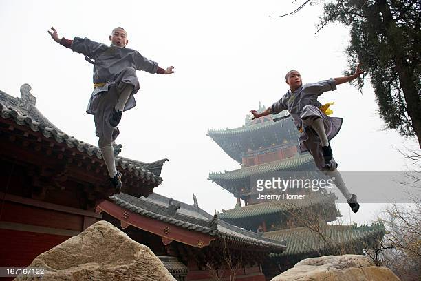Shaolin Monastery or Shaolin Temple, a Chan Buddhist temple on Mount Song, near Dengfeng, Zhengzhou, Henan province, China Shaolin monks train in...