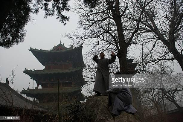 Shaolin Monastery or Shaolin Temple, a Cha?n Buddhist temple on Mount Song, near Dengfeng, Zhengzhou, Henan province, China Shaolin monks train in...